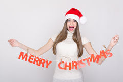 Happy young teenage girl holding Merry Christmas decoration Royalty Free Stock Photo