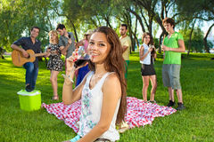 Happy young teenage girl sipping a glass of wine Royalty Free Stock Image