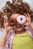 Happy young teenager girl with a donut goggle laughing stock photos