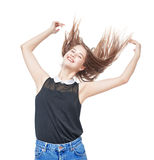 Happy young teenager girl with hands up and fluttering hair Stock Images