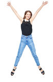 Happy young teenager girl jumping isolated Royalty Free Stock Images