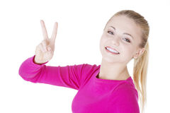 Happy young teenager girl showing victory sign Royalty Free Stock Photo