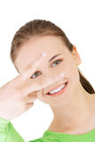 Happy young teenager girl showing victory sign Stock Photography