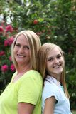 Happy young teenager with her mother stock photo
