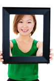 happy young teenager holding a picture frame Stock Photos