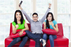 Happy young teenager watching tv at home Stock Images
