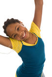 Happy young teenager wearing earphones Royalty Free Stock Image