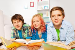 Happy young teens read books and smile Stock Photos