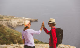 Happy young tourist couple hiking in mountains Stock Photos