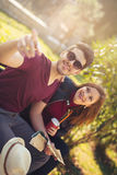Happy young tourist couple sitting on the bench Royalty Free Stock Photo