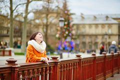Happy young tourist in Paris on a Christmas day Stock Photo