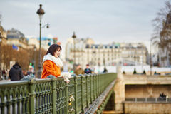 Happy young tourist in Paris on a winter day Royalty Free Stock Photo