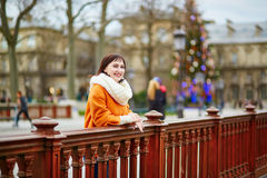 Happy young tourist in Paris on a winter day Royalty Free Stock Image