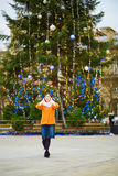 Happy young tourist in Paris on a winter day Stock Photos
