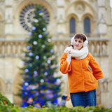 Happy young tourist in Paris on a winter day Stock Image
