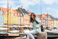 Happy young tourist woman with backpack at Copenhagen Royalty Free Stock Image