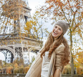 Happy young tourist woman near Eiffel tower having fun time Stock Images
