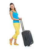 Happy young tourist woman with wheel bag Royalty Free Stock Images