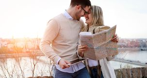 Happy tourists sightseeing city with map. Happy young tourists sightseeing city with map Stock Photography