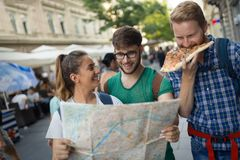 Happy tourists traveling and sightseeing. Happy young tourists traveling and sightseeing city Stock Photo