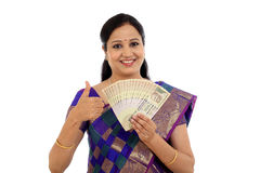 Happy young traditional woman holding Indian currency Stock Images