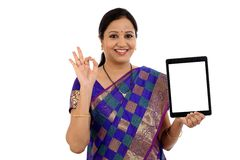 Happy young traditional woman holding Indian currency royalty free stock photography