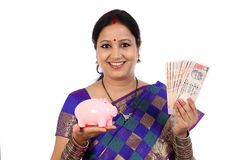 Happy young traditional woman holding Indian currency Royalty Free Stock Images