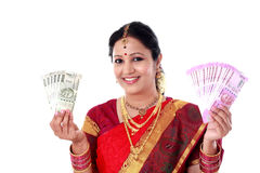 Happy young traditional woman holding Indian currency Royalty Free Stock Image