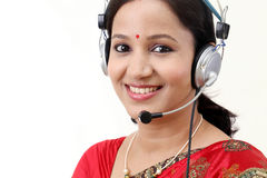 Happy young traditional woman wearing headset Stock Photo