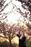 Happy young travel dancer woman enjoying free time in a sakura cherry blossom park - Caucasian white redhead girl - royalty free stock images