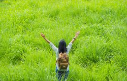 Happy young traveler woman backpacker raised arm up to sky enjoy Royalty Free Stock Image