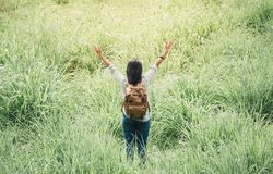 Happy young traveler woman backpacker raised arm up to sky enjoy Royalty Free Stock Images