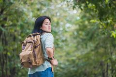 Happy young traveler woman backpacker travel in green natural forest ,greenery fresh air,Freedom wanderlust concept,Alone solo jo. Urney stock image