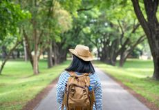 Happy young traveler woman backpacker travel in green natural forest ,greenery fresh air,Freedom wanderlust concept,Alone solo. Journey royalty free stock photos