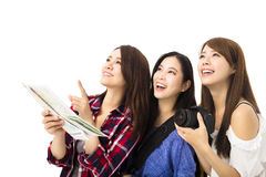 Happy young traveling women looking something Stock Image