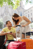 Happy young travellers using phone navigating system Stock Photos