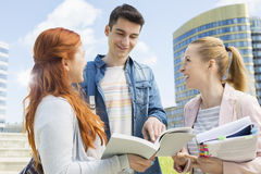 Happy young university students studying outdoors Royalty Free Stock Photography