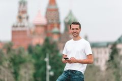 Happy young urban man in european city. Tourist man outdoors on Red Square royalty free stock photo