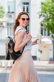 Happy young urban woman in european city. Caucasian tourist walking along the deserted streets of Europe. Warm summer stock images