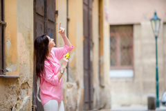 Happy young urban woman in old european streets outdoors. Caucasian tourist walking along the deserted streets of Europe Royalty Free Stock Photo