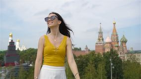Happy young urban woman in european city. stock footage