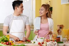 Cheerful couple cooking dinner royalty free stock image