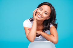Happy young vietnamese woman talking on the phone Royalty Free Stock Photo