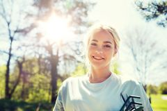 Happy young volunteer woman outdoors. People, volunteering and environment concept - happy young volunteer woman outdoors royalty free stock photos