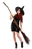 Happy young witch with a broom, isolated on white studio backgro Royalty Free Stock Photography