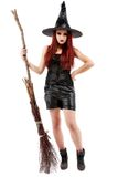 happy young witch with a broom Royalty Free Stock Photography