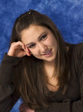 Happy young woman. Portrait of a young woman against a blue background Royalty Free Stock Photos