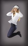 Happy young woman. Is jumping exercise Royalty Free Stock Photography