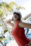 Happy Young Woman. In glass and hat Royalty Free Stock Photography