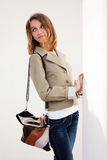 Happy young fashion woman with handbag Stock Photography
